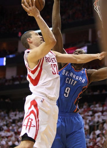 Apr 27, 2013; Houston, TX, USA; Houston Rockets shooting guard Francisco Garcia (32) attempts to score during the second quarter as Oklahoma City Thunder power forward Serge Ibaka (9) defends during game three in the first round of the 2013 NBA playoffs at the Toyota Center. Mandatory Credit: Troy Taormina-USA TODAY Sports