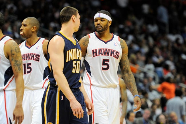 Apr 27, 2013; Atlanta, GA, USA; Indiana Pacers power forward Tyler Hansbrough (50) talks with Atlanta Hawks small forward Josh Smith (5) during the second half of game three of the first round of the 2013 NBA playoffs at Philips Arena. The Hawks defeated the Pacers 90-69. Mandatory Credit: Dale Zanine-USA TODAY Sports