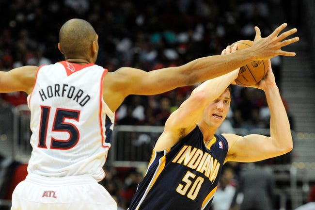 Apr 27, 2013; Atlanta, GA, USA; Indiana Pacers power forward Tyler Hansbrough (50) tries to pass around Atlanta Hawks center Al Horford (15) during the second half of game three of the first round of the 2013 NBA playoffs at Philips Arena. The Hawks defeated the Pacers 90-69. Mandatory Credit: Dale Zanine-USA TODAY Sports