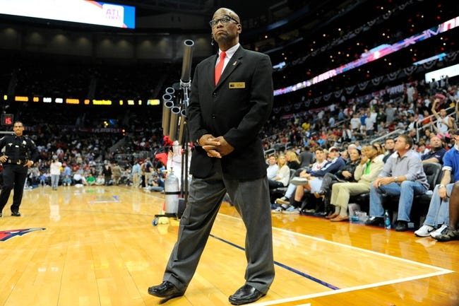 Apr 27, 2013; Atlanta, GA, USA; A security guard watches the crowd with the tee shirt as he stands in front of the t-shirt cannon during a timeout in the game between the Indiana Pacers and the Atlanta Hawks during the second half of game three of the first round of the 2013 NBA playoffs at Philips Arena. The Hawks defeated the Pacers 90-69. Mandatory Credit: Dale Zanine-USA TODAY Sports