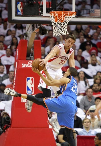 Apr 27, 2013; Houston, TX, USA; Houston Rockets small forward Chandler Parsons (25) attempts to block a shot by Oklahoma City Thunder shooting guard Kevin Martin (23) in the first quarter during game three in the first round of the 2013 NBA playoffs at the Toyota Center. Mandatory Credit: Troy Taormina-USA TODAY Sports
