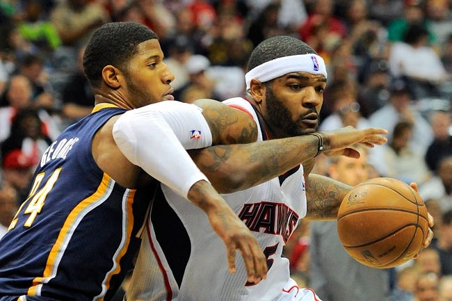 Apr 27, 2013; Atlanta, GA, USA; Atlanta Hawks small forward Josh Smith (5) tries to drive past Indiana Pacers small forward Paul George (24) during the first half during game three in the first round of the 2013 NBA playoffs at Philips Arena.The Hawks defeated the Pacers 90-69. Mandatory Credit: Dale Zanine-USA TODAY Sports
