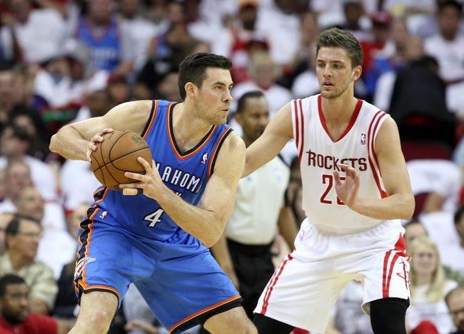 Apr 27, 2013; Houston, TX, USA; Oklahoma City Thunder power forward Nick Collison (4) controls the ball in the second quarter as Houston Rockets small forward Chandler Parsons (25) defends during game three in the first round of the 2013 NBA playoffs at the Toyota Center. Mandatory Credit: Troy Taormina-USA TODAY Sports