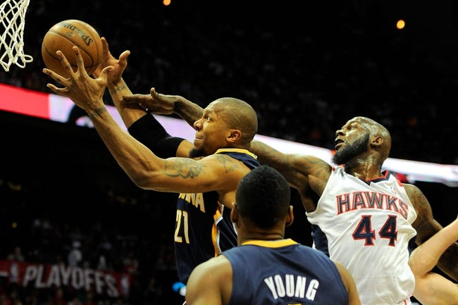 Apr 27, 2013; Atlanta, GA, USA; Indiana Pacers power forward David West (21) grabs a rebound against Atlanta Hawks power forward Ivan Johnson (44) during the first half during game three in the first round of the 2013 NBA playoffs at Philips Arena.The Hawks defeated the Pacers 90-69. Mandatory Credit: Dale Zanine-USA TODAY Sports
