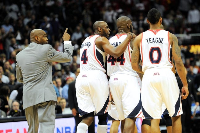 Apr 27, 2013; Atlanta, GA, USA; Atlanta Hawks head coach Larry Drew (left) directs his players back to the bench after an altercation against the Indiana Pacers during the first half during game three in the first round of the 2013 NBA playoffs at Philips Arena.The Hawks defeated the Pacers 90-69. Mandatory Credit: Dale Zanine-USA TODAY Sports