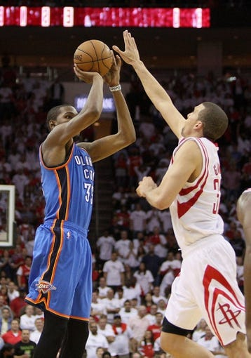Apr 27, 2013; Houston, TX, USA; Oklahoma City Thunder small forward Kevin Durant (35) attempts a shot during the fourth quarter as Houston Rockets shooting guard Francisco Garcia (32) defends in game three of the first round of the 2013 NBA playoffs at the Toyota Center. Mandatory Credit: Troy Taormina-USA TODAY Sports