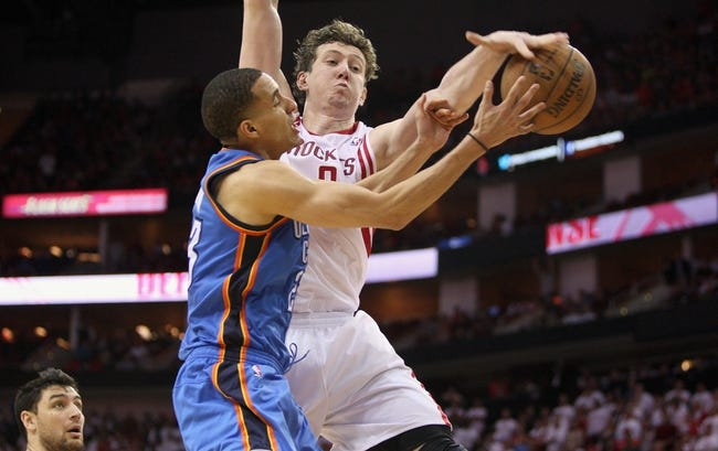 Apr 27, 2013; Houston, TX, USA; Houston Rockets center Omer Asik (3) attempts to block a shot by Oklahoma City Thunder shooting guard Kevin Martin (23) in the fourth quarter of game three of the first round of the 2013 NBA playoffs at the Toyota Center. Mandatory Credit: Troy Taormina-USA TODAY Sports