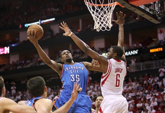 Apr 27, 2013; Houston, TX, USA; Oklahoma City Thunder small forward Kevin Durant (35) shoots during the fourth quarter as Houston Rockets power forward Terrence Jones (6) defends during game three of the first round of the 2013 NBA playoffs at the Toyota Center. Mandatory Credit: Troy Taormina-USA TODAY Sports