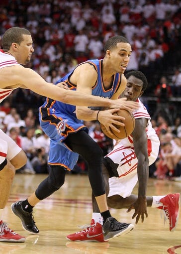 Apr 27, 2013; Houston, TX, USA; Oklahoma City Thunder shooting guard Kevin Martin (23) drives the ball to the basket during the fourth quarter against the Houston Rockets in game three of the first round of the 2013 NBA playoffs at the Toyota Center. Mandatory Credit: Troy Taormina-USA TODAY Sports