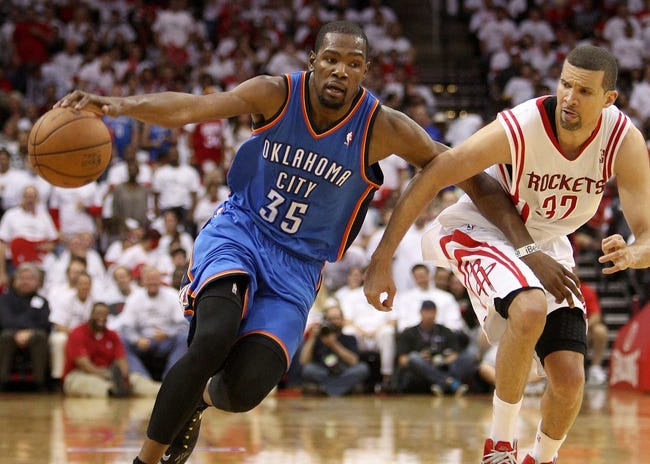 Apr 27, 2013; Houston, TX, USA; Oklahoma City Thunder small forward Kevin Durant (35) controls the ball during the third quarter as Houston Rockets shooting guard Francisco Garcia (32) defends in game three of the first round of the 2013 NBA playoffs at the Toyota Center. Mandatory Credit: Troy Taormina-USA TODAY Sports