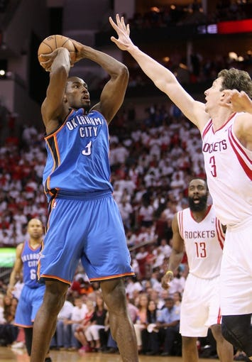 Apr 27, 2013; Houston, TX, USA; Oklahoma City Thunder power forward Serge Ibaka (9) attempts a shot during the fourth quarter against the Houston Rockets in game three of the first round of the 2013 NBA playoffs at the Toyota Center. Mandatory Credit: Troy Taormina-USA TODAY Sports