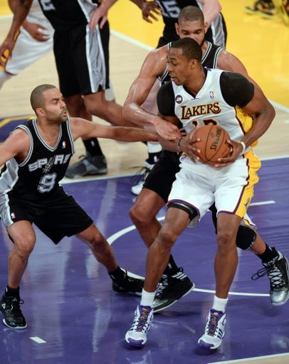 Apr 28, 2013; Los Angeles, CA, USA;  San Antonio Spurs guard Tony Parker and forward Tim Duncan surround the Los Angeles Lakers center Dwight Howard during 1st half action in game four of the first round of the 2013 NBA playoffs at the Staples Center. Mandatory Credit: Robert Hanashiro-USA TODAY Sports