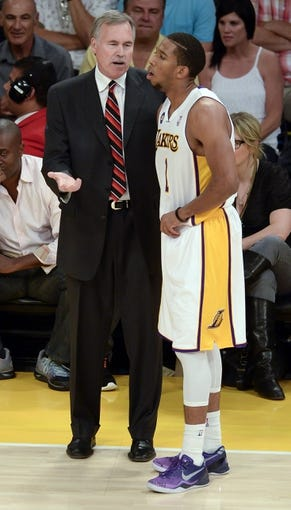 Apr 28, 2013; Los Angeles, CA, USA; Los Angeles Lakers head coach Mike D'Antoni talks to point guard Darius Morris (1) during 1st half action against the Spurs in game four of the first round of the 2013 NBA playoffs at the Staples Center. Mandatory Credit: Robert Hanashiro-USA TODAY Sports