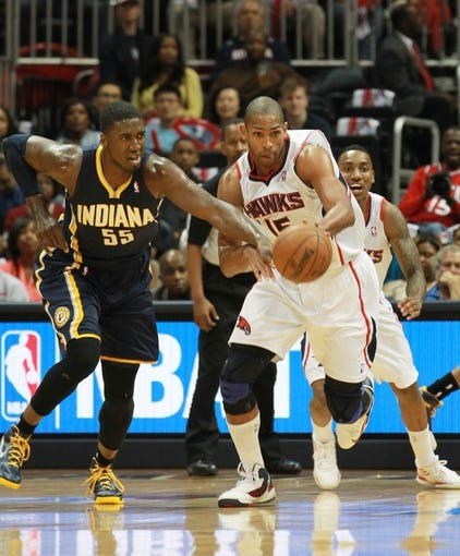 Apr 29, 2013; Atlanta, GA, USA; Atlanta Hawks forward Al Horford (15) goes for the ball along with Indiana Pacers center Roy Hibbert (55) in game four of the first round of the 2013 NBA playoffs at Philips Arena. Mandatory Credit: Marvin Gentry-USA TODAY Sports