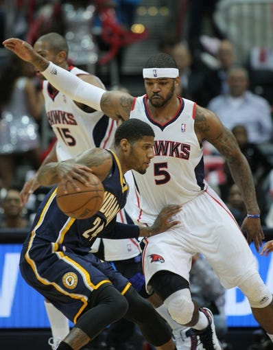 Apr 29, 2013; Atlanta, GA, USA; Atlanta Hawks forward Josh Smith (5) guards Indiana Pacers forward Paul George (24) in game four of the first round of the 2013 NBA playoffs at Philips Arena. Mandatory Credit: Marvin Gentry-USA TODAY Sports