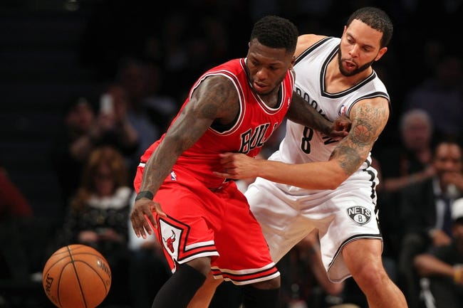 Apr 29, 2013; Brooklyn, NY, USA; Chicago Bulls guard Nate Robinson (2) is fouled on the floor by Brooklyn Nets guard Deron Williams (8) during the third quarter of game five of the first round of the 2013 NBA playoffs at the Barclays Center. Mandatory Credit: Brad Penner-USA TODAY Sports