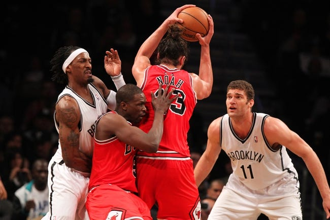 Apr 29, 2013; Brooklyn, NY, USA; Chicago Bulls center Joakim Noah (13) grabs a rebound in front of Chicago Bulls forward Luol Deng (9) and Brooklyn Nets forward Gerald Wallace (45) and Brooklyn Nets center Brook Lopez (11) during the third quarter of game five of the first round of the 2013 NBA playoffs at the Barclays Center. Mandatory Credit: Brad Penner-USA TODAY Sports
