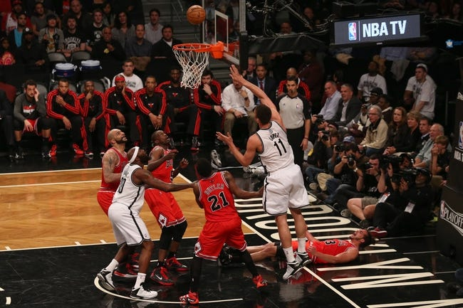 Apr 29, 2013; Brooklyn, NY, USA; Brooklyn Nets center Brook Lopez (11) shoots during the third quarter against the Chicago Bulls in game five of the first round of the 2013 NBA playoffs at the Barclays Center. Brooklyn won 110-91.  Mandatory Credit: Anthony Gruppuso-USA TODAY Sports