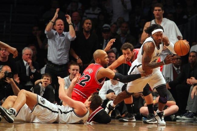 Apr 29, 2013; Brooklyn, NY, USA; Brooklyn Nets forward Gerald Wallace (45) comes away with a loose ball in front of forward Kris Humphries (43) and Chicago Bulls forward Taj Gibson (22) and guard Marco Belinelli (8) fight for a loose ball during the fourth quarter of game five of the first round of the 2013 NBA playoffs at the Barclays Center. Mandatory Credit: Brad Penner-USA TODAY Sports