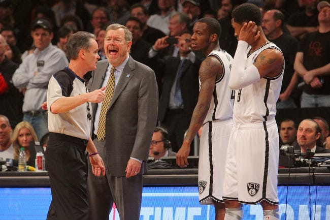 Apr 29, 2013; Brooklyn, NY, USA; Brooklyn Nets head coach P.J. Carlesimo argues with official Mike Callahan (24) during the fourth quarter of game five of the first round of the 2013 NBA playoffs against the Chicago Bulls at the Barclays Center. Mandatory Credit: Brad Penner-USA TODAY Sports