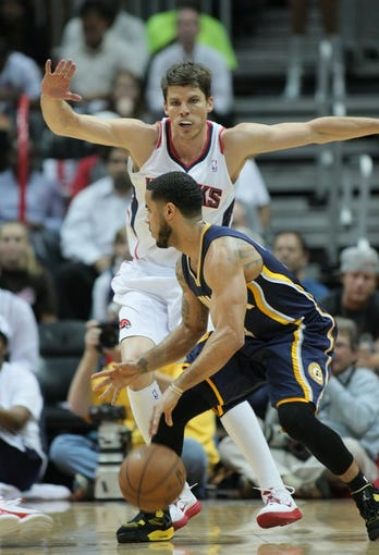 Apr 29, 2013; Atlanta, GA, USA; Atlanta Hawks guard Kyle Korver (26) guards Indian Pacers D.J. Augustin (14) in game four of the first round of the 2013 NBA playoffs at Philips Arena. Mandatory Credit: Marvin Gentry-USA TODAY Sports