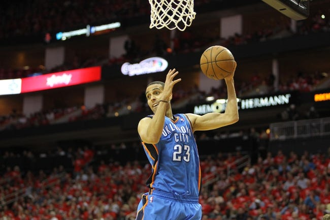 Apr 29, 2013; Houston, TX, USA; Oklahoma City Thunder shooting guard Kevin Martin (23) grabs a rebound against the Houston Rockets in the second quarter in game four of the first round of the 2013 NBA playoffs at the Toyota Center. Mandatory Credit: Brett Davis-USA TODAY Sports