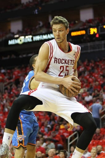 Apr 29, 2013; Houston, TX, USA; Houston Rockets small forward Chandler Parsons (25) grabs a rebound against the Oklahoma City Thunder in the second quarter in game four of the first round of the 2013 NBA playoffs at the Toyota Center. Mandatory Credit: Brett Davis-USA TODAY Sports