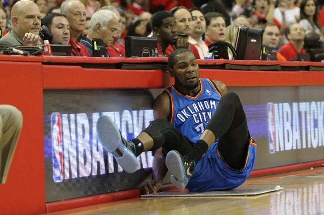 Apr 29, 2013; Houston, TX, USA; Oklahoma City Thunder small forward Kevin Durant (35) falls to the ground against the Houston Rockets in the third quarter in game four of the first round of the 2013 NBA playoffs at the Toyota Center. The Rockets defeated the Thunder 105-103. Mandatory Credit: Brett Davis-USA TODAY Sports