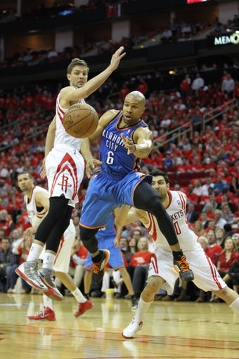 Apr 29, 2013; Houston, TX, USA; Oklahoma City Thunder point guard Derek Fisher (6) passes the ball against the Houston Rockets in the fourth quarter in game four of the first round of the 2013 NBA playoffs at the Toyota Center. The Rockets defeated the Thunder 105-103. Mandatory Credit: Brett Davis-USA TODAY Sports