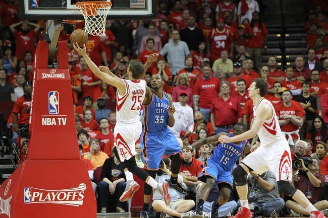 Apr 29, 2013; Houston, TX, USA; Houston Rockets small forward Chandler Parsons (25) takes a shot over Oklahoma City Thunder small forward Kevin Durant (35) in the fourth quarter in game four of the first round of the 2013 NBA playoffs at the Toyota Center. The Rockets defeated the Thunder 105-103. Mandatory Credit: Brett Davis-USA TODAY Sports