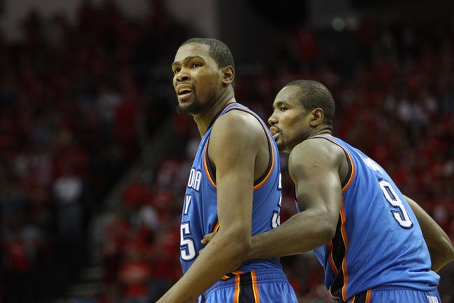 Apr 29, 2013; Houston, TX, USA; Oklahoma City Thunder small forward Kevin Durant (35) and power forward Serge Ibaka (9) show emotion after a foul call against the Houston Rockets in the fourth quarter in game four of the first round of the 2013 NBA playoffs at the Toyota Center. The Rockets defeated the Thunder 105-103. Mandatory Credit: Brett Davis-USA TODAY Sports