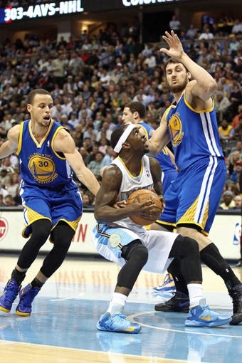Apr 30, 2013; Denver, CO, USA; Golden State Warriors center Andrew Bogut (12) and point guard Stephen Curry (30) guard Denver Nuggets point guard Ty Lawson (3) in the third quarter in game five of the first round of the 2013 NBA Playoffs at the Pepsi Center. The Nuggets won 107-100. Mandatory Credit: Isaiah J. Downing-USA TODAY Sports