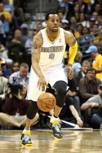 Apr 30, 2013; Denver, CO, USA; Denver Nuggets shooting guard Andre Iguodala (9) controls the ball in the third quarter against the Golden State Warriors in game five of the first round of the 2013 NBA Playoffs at the Pepsi Center. The Nuggets won 107-100. Mandatory Credit: Isaiah J. Downing-USA TODAY Sports
