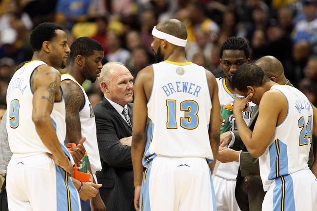 Apr 30, 2013; Denver, CO, USA; Denver Nuggets head coach George Karl talks with his team during a time out in the fourth quarter against the Golden State Warriors in game five of the first round of the 2013 NBA Playoffs at the Pepsi Center. The Nuggets won 107-100. Mandatory Credit: Isaiah J. Downing-USA TODAY Sports