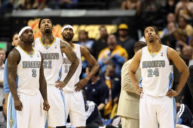 Apr 30, 2013; Denver, CO, USA; Denver Nuggets point guard Ty Lawson (3) , shooting guard Wilson Chandler (21) and point guard Andre Miller (24) watch a replay in the second quarter against the Golden State Warriors in game five of the first round of the 2013 NBA Playoffs at the Pepsi Center. The Nuggets won 107-100. Mandatory Credit: Isaiah J. Downing-USA TODAY Sports
