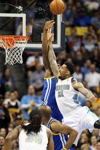 Apr 30, 2013; Denver, CO, USA; Golden State Warriors center Festus Ezeli (31) blocks the shot of Denver Nuggets shooting guard Wilson Chandler (21) in the second quarter in game five of the first round of the 2013 NBA Playoffs at the Pepsi Center. The Nuggets won 107-100. Mandatory Credit: Isaiah J. Downing-USA TODAY Sports