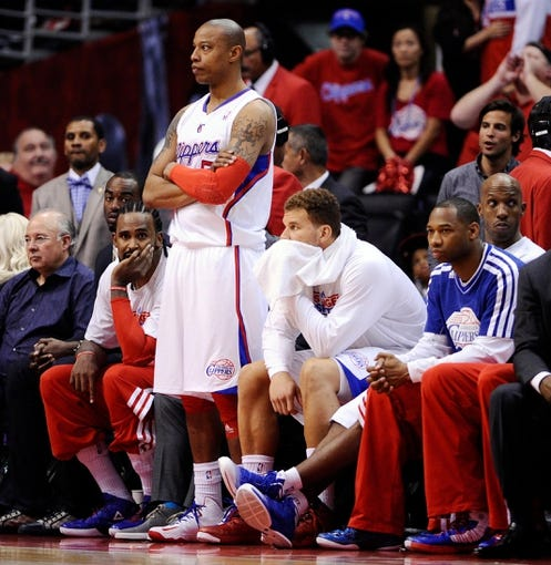 Apr 30, 2013; Los Angeles, CA, USA; Los Angeles Clippers center Ronny Turiaf (21), small forward Caron Butler (5) and forward Blake Griffin (32) watch from the bench as the Clippers lose to the Grizzlies in game five of the first round of the 2013 NBA Playoffs at the Staples Center. Mandatory Credit: Robert Hanashiro-USA TODAY Sports