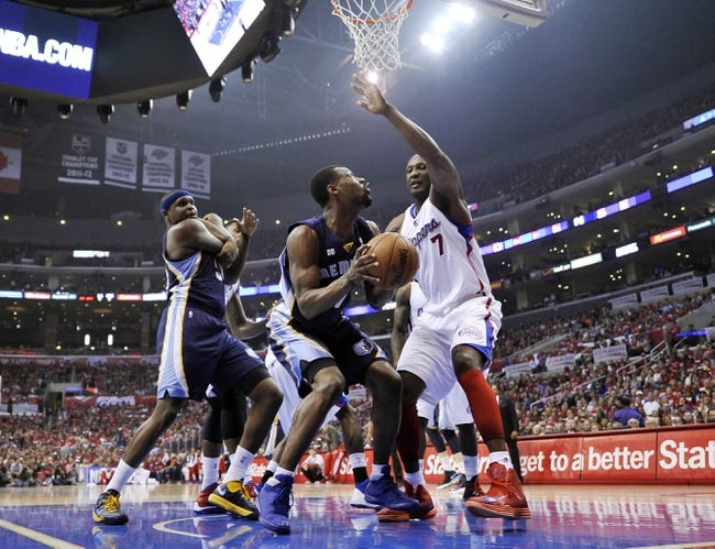 Apr 30, 2013; Los Angeles, CA, USA; Memphis Grizzlies shooting guard Tony Allen (9) tries drives the baseline against Los Angeles Clippers player Lamar Odom in game five of the first round of the 2013 NBA Playoffs at the Staples Center. Mandatory Credit: Robert Hanashiro-USA TODAY Sports