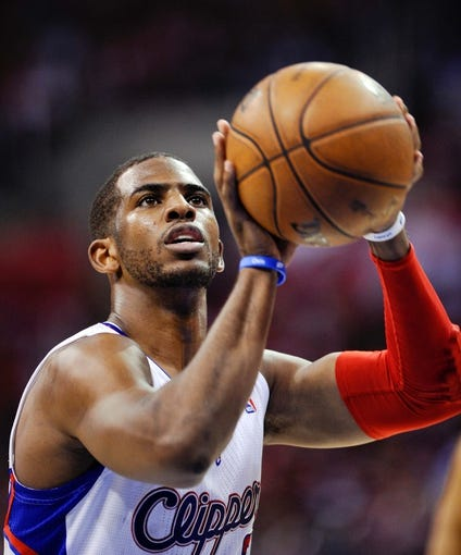 Apr 30, 2013; Los Angeles, CA, USA; Los Angeles Clippers point guard Chris Paul (3) shoots a free-throw during 1st half action against the Memphis Grizzlies in game five of the first round of the 2013 NBA Playoffs at the Staples Center. Mandatory Credit: Robert Hanashiro-USA TODAY Sports