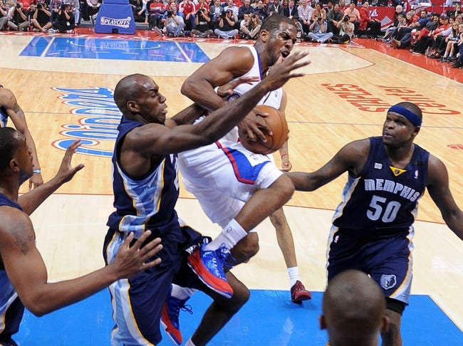 Apr 30, 2013; Los Angeles, CA, USA;  Memphis Grizzlies small forward Quincy Pondexter (20) fouls Los Angeles Clippers point guard Chris Paul (3) in game 5 of the first round of the 2013 NBA Playoffs against the Memphis Grizzlies at the Staples Center. Grizzlies won 103-93. Mandatory Credit: Jayne Kamin-Oncea-USA TODAY Sports