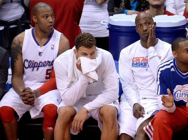Apr 30, 2013; Los Angeles, CA, USA;  Los Angeles Clippers small forward Caron Butler (5), power forward Blake Griffin (middle) and point guard Chauncey Billups (right) on the bench at the end of game five of the first round of the 2013 NBA Playoffs against the Memphis Grizzlies at the Staples Center. Grizzlies won 103-93. Mandatory Credit: Jayne Kamin-Oncea-USA TODAY Sports