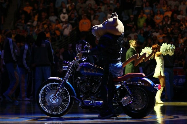 Apr 23, 2013; Denver, CO, USA; Denver Nuggets mascot Rocky enters the arena on a motorcycle before the start of the game against the Golden State Warriors during game two in the first round of the 2013 NBA playoffs at the Pepsi Center. The Warriors won 131-117. Mandatory Credit: Isaiah J. Downing-USA TODAY Sports