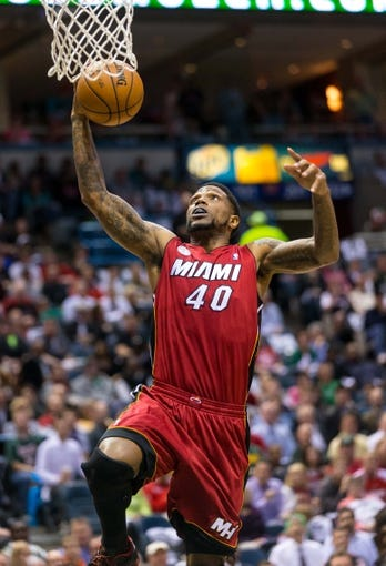 Apr 25, 2013; Milwaukee, WI, USA; Miami Heat forward Udonis Haslem (40) during game three of the first round of the 2013 NBA playoffs against the Milwaukee Bucks at BMO Harris Bradley Center.  Miami won 104-91.  Mandatory Credit: Jeff Hanisch-USA TODAY Sports