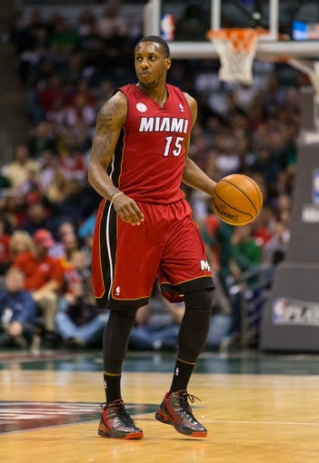 Apr 25, 2013; Milwaukee, WI, USA; Miami Heat guard Mario Chalmers (15) during game three of the first round of the 2013 NBA playoffs against the Milwaukee Bucks at BMO Harris Bradley Center.  Miami won 104-91.  Mandatory Credit: Jeff Hanisch-USA TODAY Sports