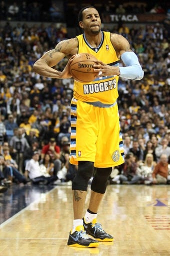 Apr 23, 2013; Denver, CO, USA; Denver Nuggets shooting guard Andre Iguodala (9) controls the ball in the third quarter against the Golden State Warriors during game two in the first round of the 2013 NBA playoffs at the Pepsi Center. The Warriors won 131-117. Mandatory Credit: Isaiah J. Downing-USA TODAY Sports