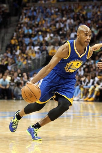 Apr 23, 2013; Denver, CO, USA; Golden State Warriors point guard Jarrett Jack (2) controls the ball during the first quarter against the Denver Nuggets during game two in the first round of the 2013 NBA playoffs at the Pepsi Center. The Warriors won 131-117. Mandatory Credit: Isaiah J. Downing-USA TODAY Sports