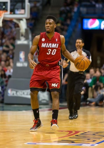 Apr 25, 2013; Milwaukee, WI, USA; Miami Heat guard Norris Cole (30) during game three of the first round of the 2013 NBA playoffs against the Milwaukee Bucks at BMO Harris Bradley Center.  Miami won 104-91.  Mandatory Credit: Jeff Hanisch-USA TODAY Sports