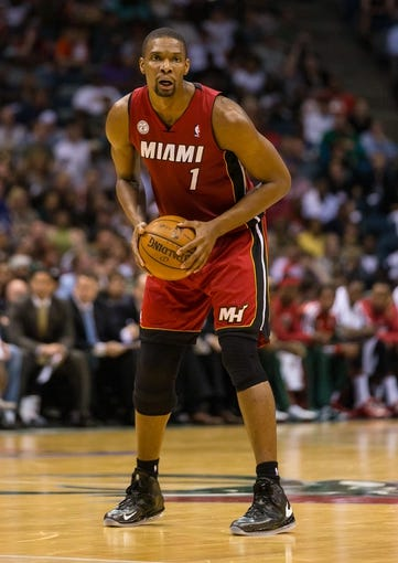 Apr 28, 2013; Milwaukee, WI, USA; Miami Heat center Chris Bosh (1) during game four of the first round of the 2013 NBA playoffs against the Milwaukee Bucks at the BMO Harris Bradley Center.  Miami won 88-77.  Mandatory Credit: Jeff Hanisch-USA TODAY Sports