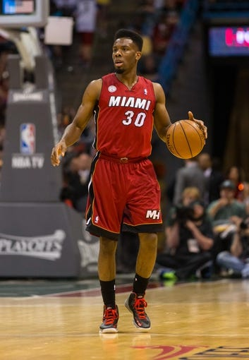 Apr 28, 2013; Milwaukee, WI, USA; Miami Heat guard Norris Cole (30) during game four of the first round of the 2013 NBA playoffs against the Milwaukee Bucks at the BMO Harris Bradley Center.  Miami won 88-77.  Mandatory Credit: Jeff Hanisch-USA TODAY Sports