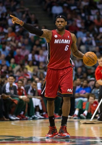 Apr 28, 2013; Milwaukee, WI, USA; Miami Heat forward LeBron James (6) during game four of the first round of the 2013 NBA playoffs against the Milwaukee Bucks at the BMO Harris Bradley Center.  Miami won 88-77.  Mandatory Credit: Jeff Hanisch-USA TODAY Sports